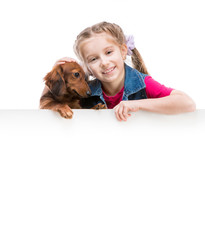 little girl  with dachshund