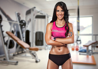 Portrait of sporty woman in gym