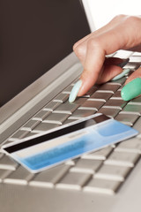 Woman's hand entering credit card information