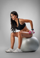 Girl doing exercise on fit-ball