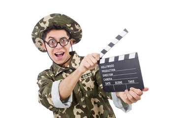 Funny soldier with movie board isolated on the white