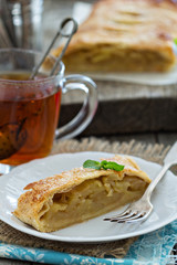Apple strudel with tea