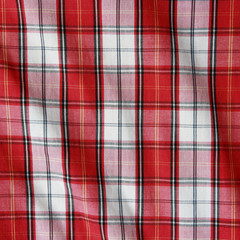 Texture of checkered picnic blanket.