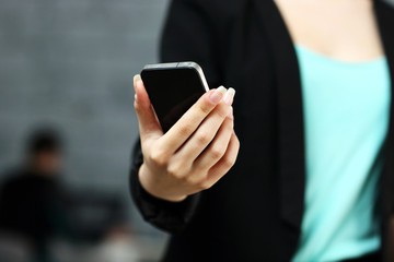 Closeup portrait of a female hands using smartphone in office