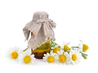 Chamomile with pharmaceutical bottle.