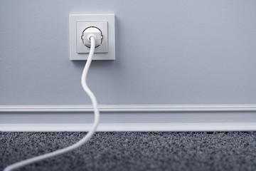 Elektrische Stecker in Steckdose