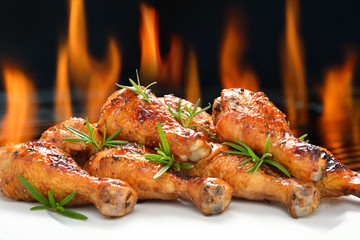 Grilled chicken legs on white plate.