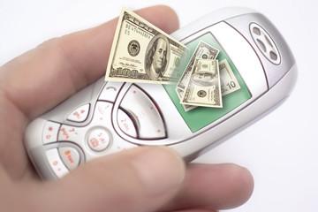 älteres Handy, Symbolbild, Geldscheine auf Display