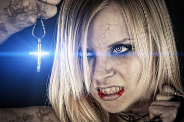 evil vampire and the bright light of the cross