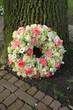 Sympathy wreath near tree