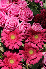 Pink roses and gerberas in a bridal arrangement