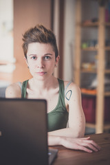 young lesbian stylish hair style woman using notebook