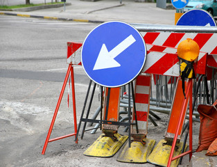 road signs with a large arrow to identify the place of work in p