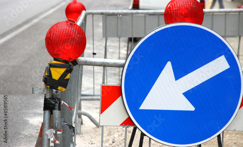 white arrow of roadwork during an excavation in roadway