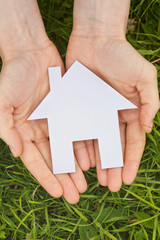 Open Hands Holding a House