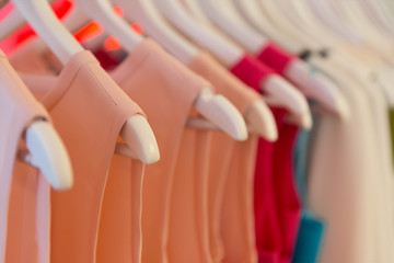 Closeup view of dresses on clothes hangers