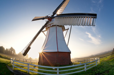 wide angle view on windmill at sunrise