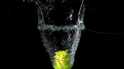 Tennis ball falling into water
