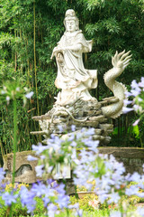 Sculptures of Chinese gods. (Kuan Yin) in the park.