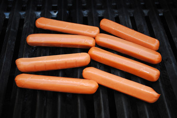 Raw Hot Dogs on a Summer Grill