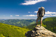 Tourist on high rocks. Active life concept