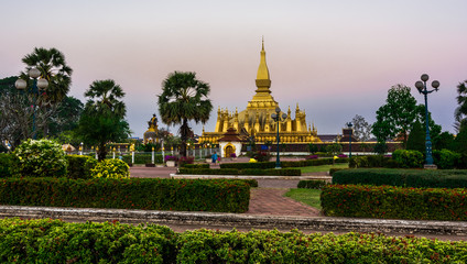 King Setthathirat statue and Pha That Luang stupa
