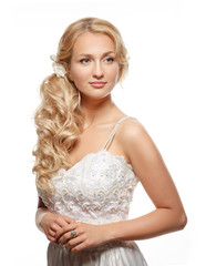 Beautiful woman with long hair wearing luxurious wedding dress
