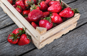 Fresh strawberries on wood table