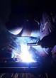 Welder on industrial workplace.