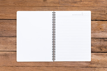 Blank notebook on old wooden background