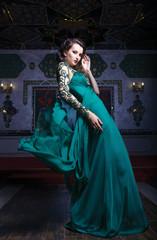 Beautiful woman in a green long dress