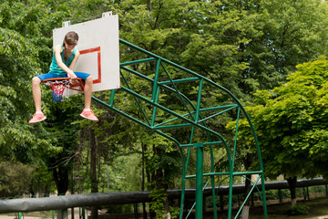 Young girl replacing a basketball net
