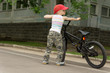 Cute macho little boy with his bicycle