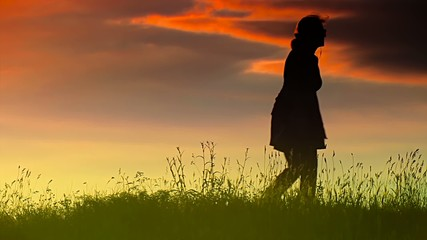 Woman walking at sunset