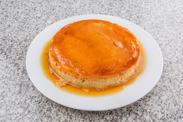 Caramel pudding on a white plate