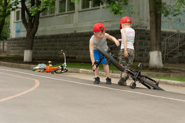 Two little boys playing with their bicycles