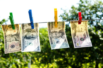 paper dollars are drying on rope