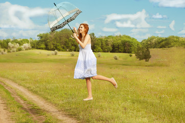 Levitating girl with umbrella fly above the ground.