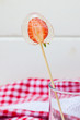 transparent lollipop with strawberries in a glass