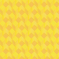 Gelbe Würfel auf Stoffmuster