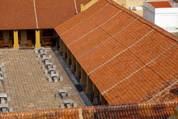 Roofs of old and new clay tiles after repair and reconstruction