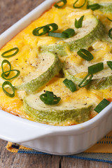 Zucchini casserole with cheese, eggs closeup vertical