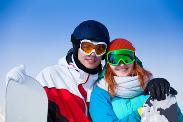 Smiling couple in ski masks together
