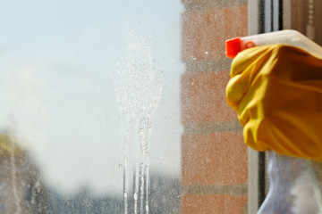 detergent jet from spray bottle on window