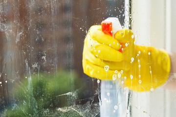 foamy liquid on window glass during washing