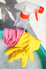 rubber glove, duster, spray bottle, soapsuds water