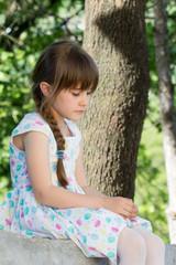 Thinked little girl outside