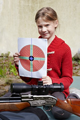 Girl with a target and a pneumatic gun