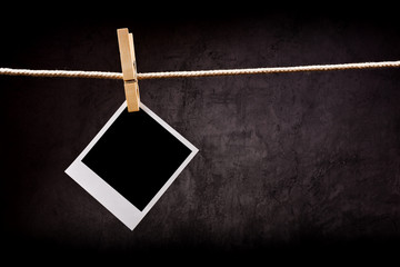 Photography paper with instant photo frame attached to rope with