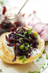 Canape with caramelized onion chutney and goat cheese